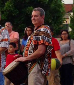 Mike Long performing West African rhythms